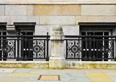Decorative Railing Panels between Stone Columns