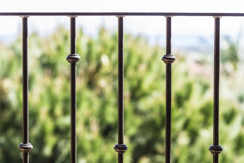decorative railings. plain bars with decorative collars railings