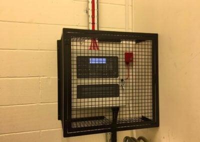 Metal cage for control unit. Bancroft's School, Woodford Green, Essex